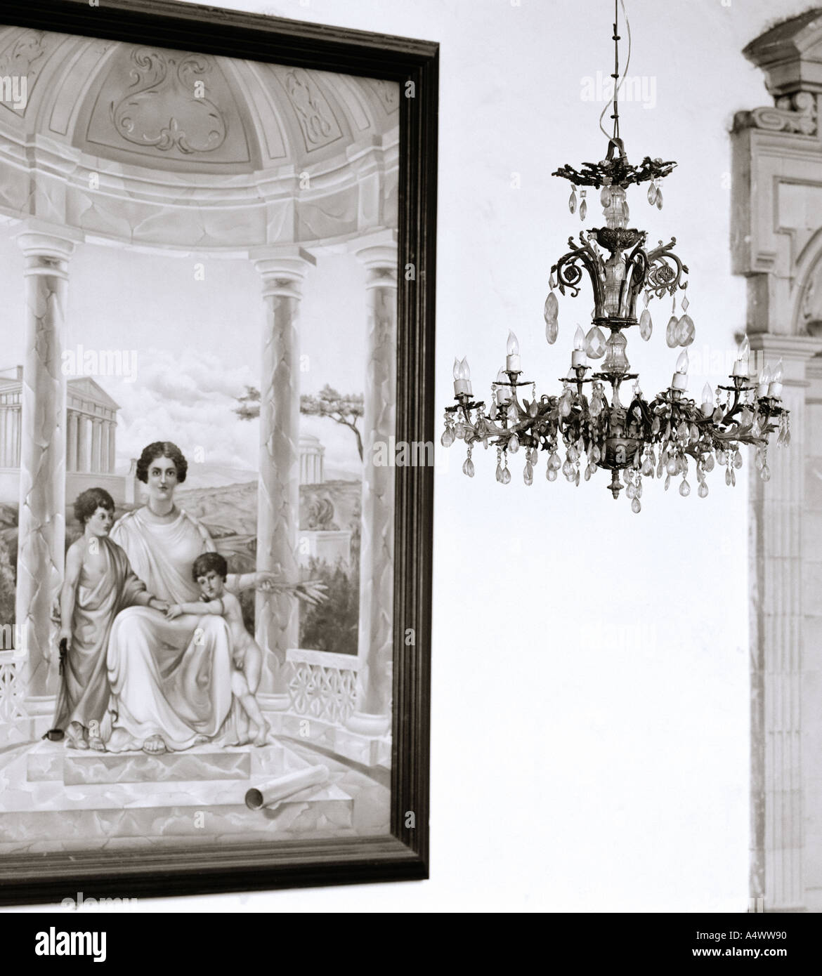 Chandelier and art painting in a house in Oaxaca City in Oaxaca State in Mexico in Latin Central America. Beauty Beautiful Serenity Travel b&w - Stock Image