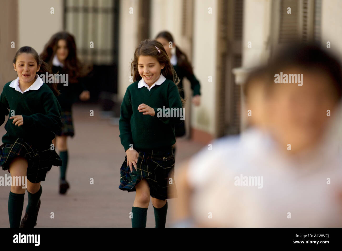 Young students running in playground Stock Photo