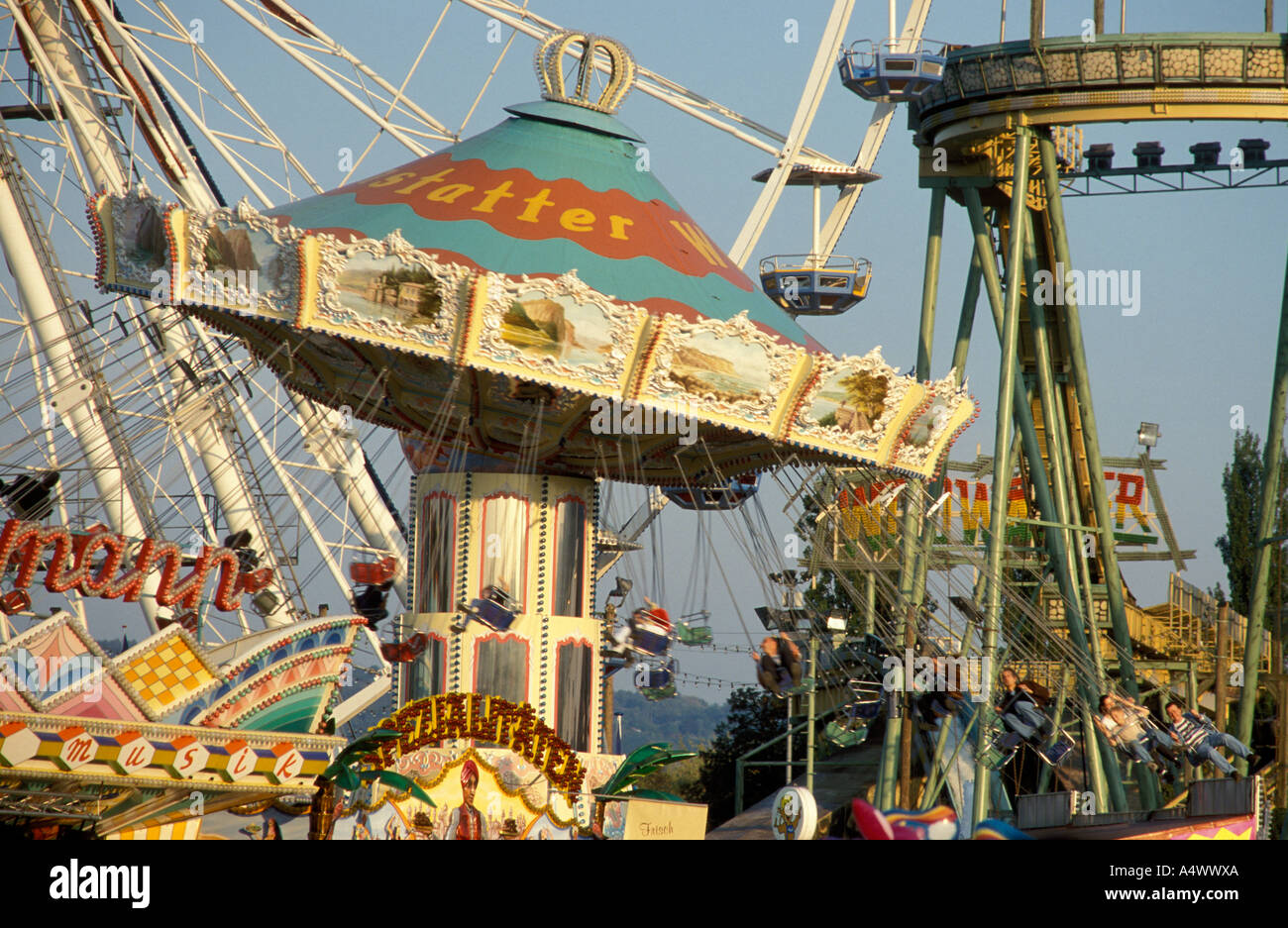 People at a merry go round at the festival Cannstatter Volksfest  Stuttgart Baden Wuerttemberg Germany Stock Photo