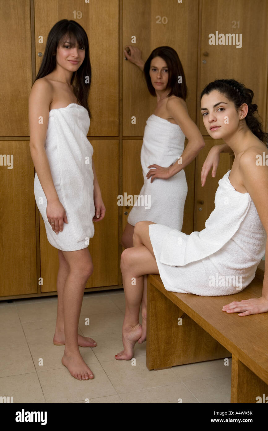 Women Wrapped In Towels In Changing Room Stock Photo