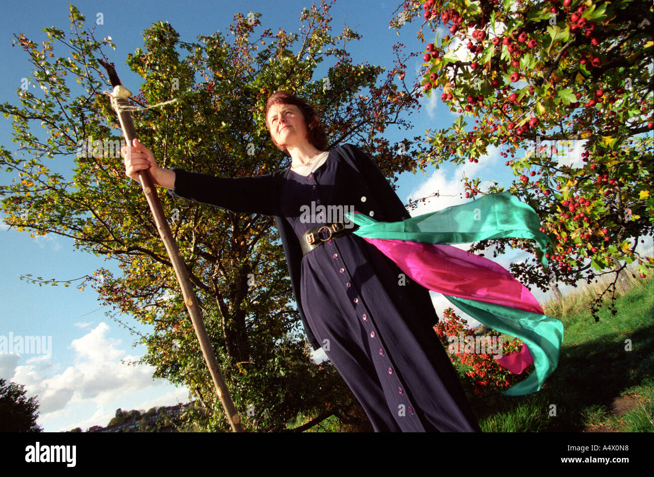 Annie Wildwood pagan priestess pictured on a hill in Bristol UK - Stock Image