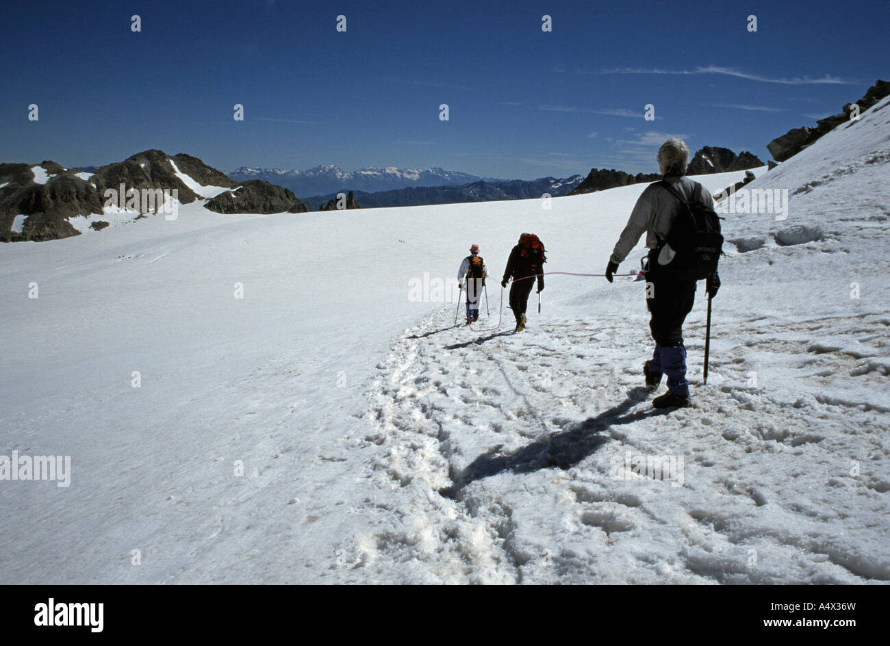 Trient Glacier A group of three climbers hiking together across the glacier Alpine region France - Stock Image