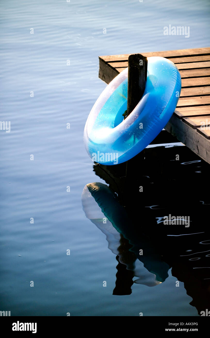 Dock and inner tube on a Lake - Stock Image