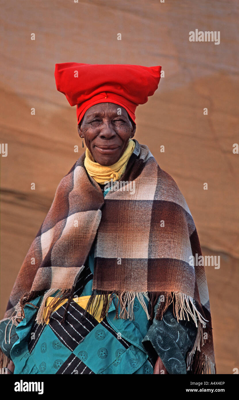 Portrait of an elderly Herero woman with red headdress at the Ma Herero Day Parade August Okahandja Namibia - Stock Image