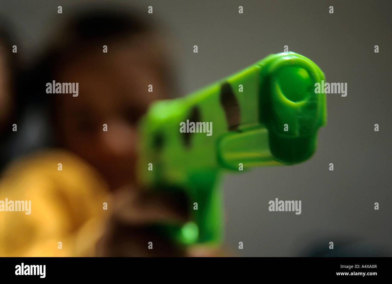 Children Holding A Gun Stock Photo