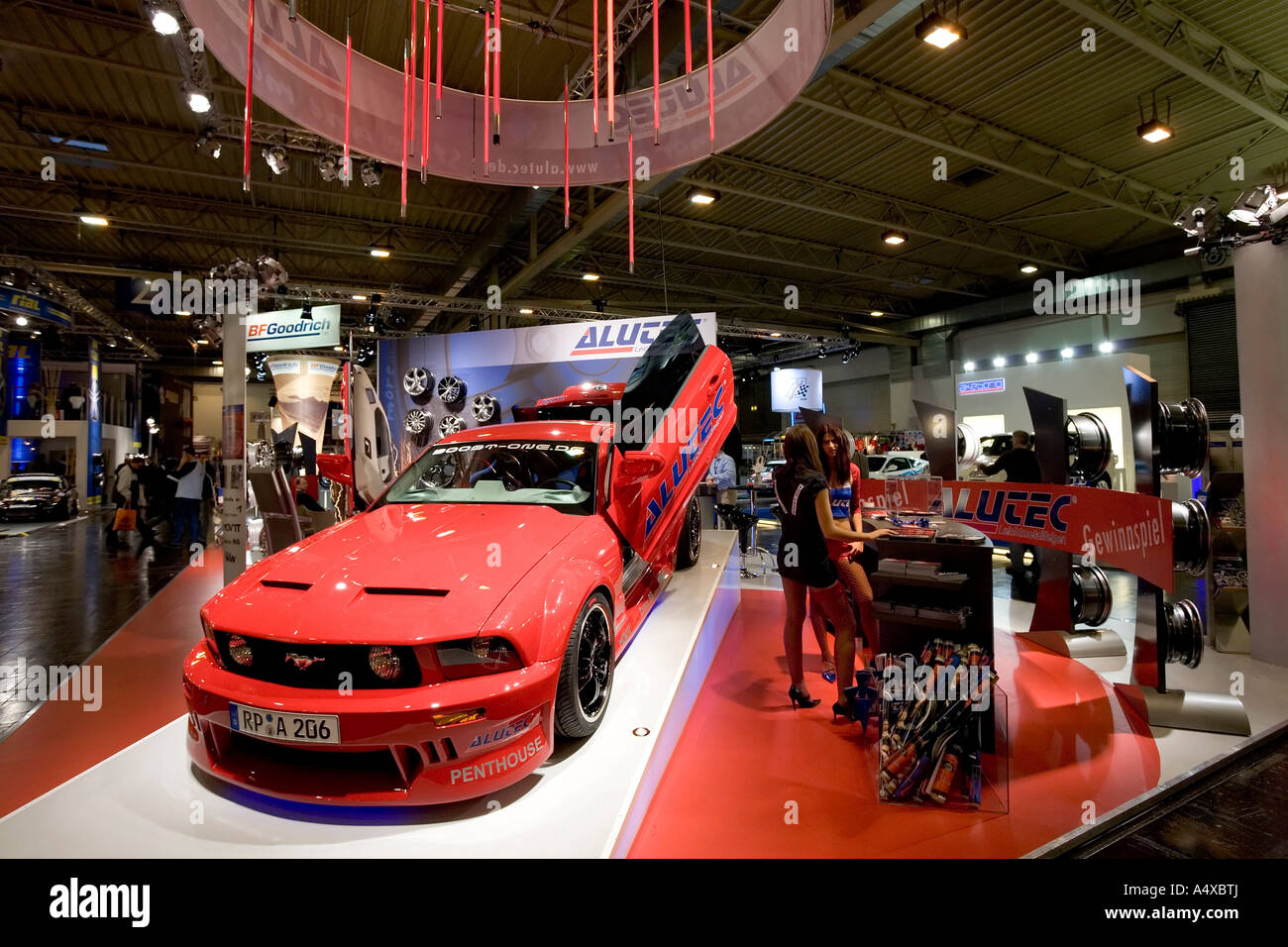Exhibition stand of an alloy wheels manufacturer at the Essen Motor Show, NRW, Germany - Stock Image