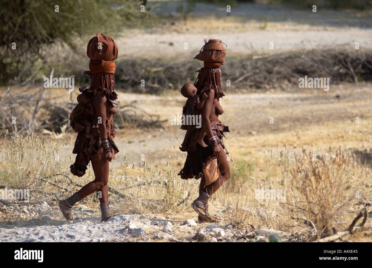 Himba woman walking - Stock Image