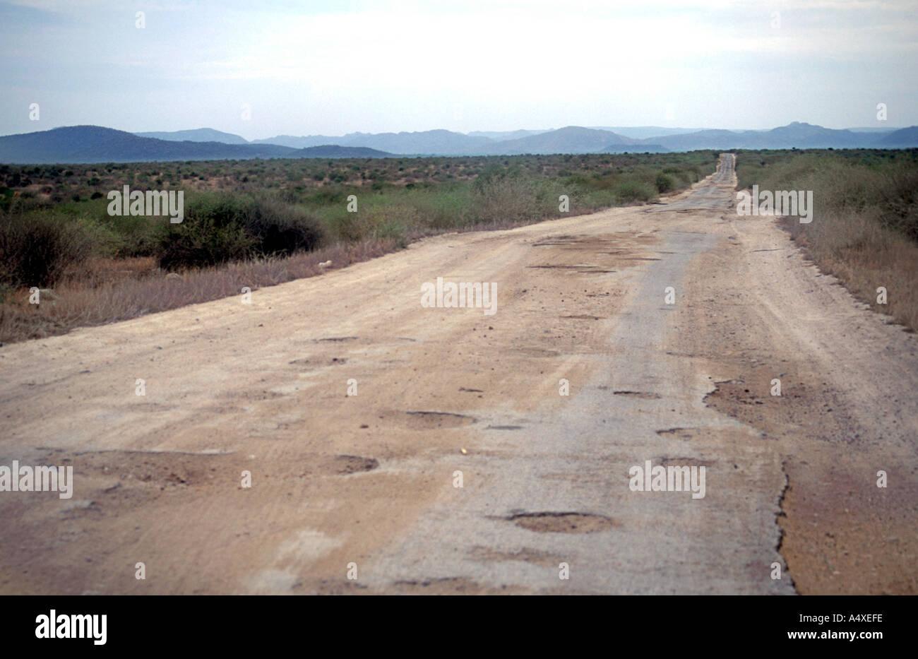 The potholed road between Lobito and Lubango in southern Angola. - Stock Image