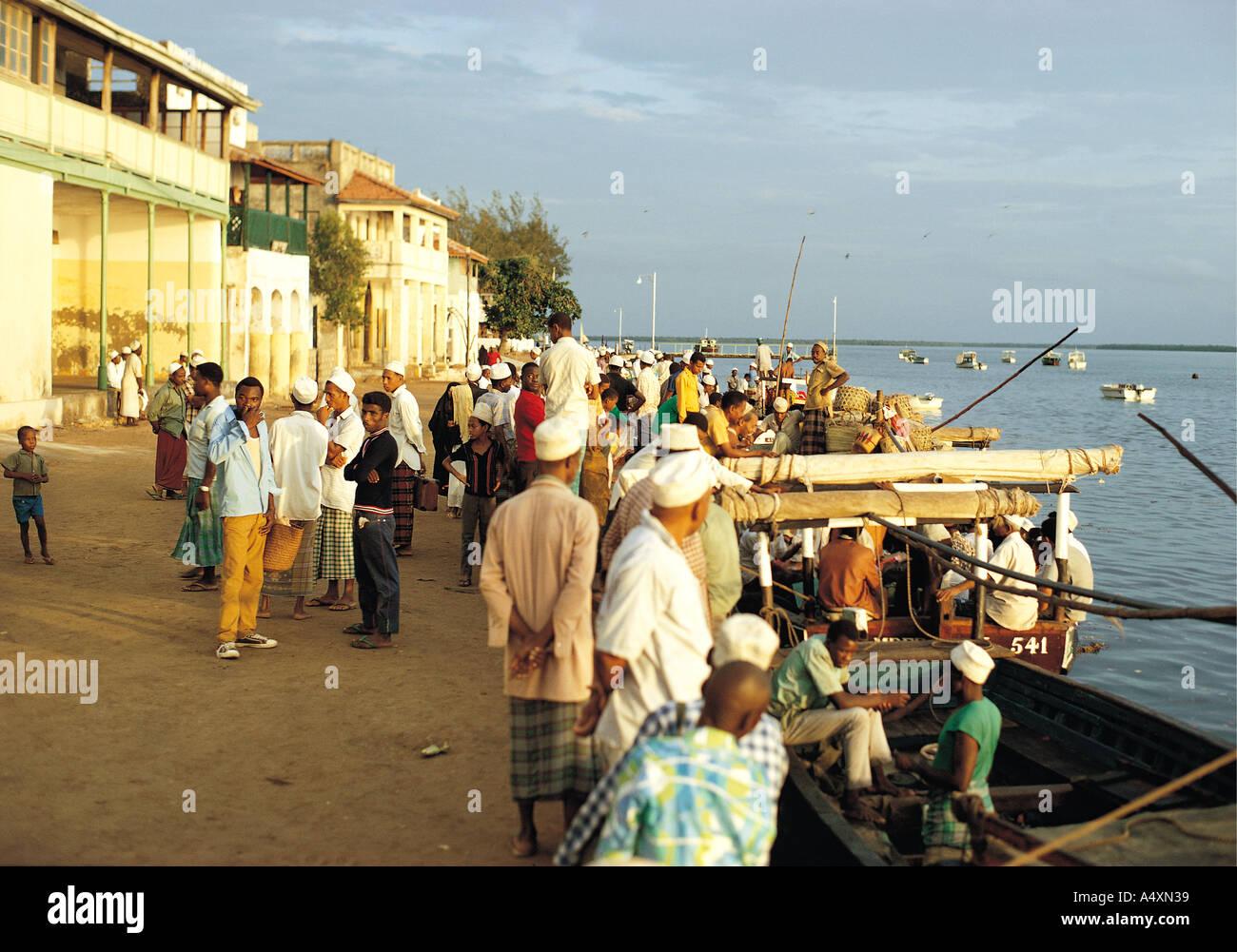 local people waiting for a ferry on lamu waterfront lamu island
