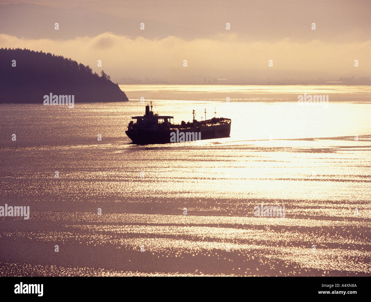 Cargo ship plies the waters around the San Juan Islands of Puget Sound in Washington State USA - Stock Image