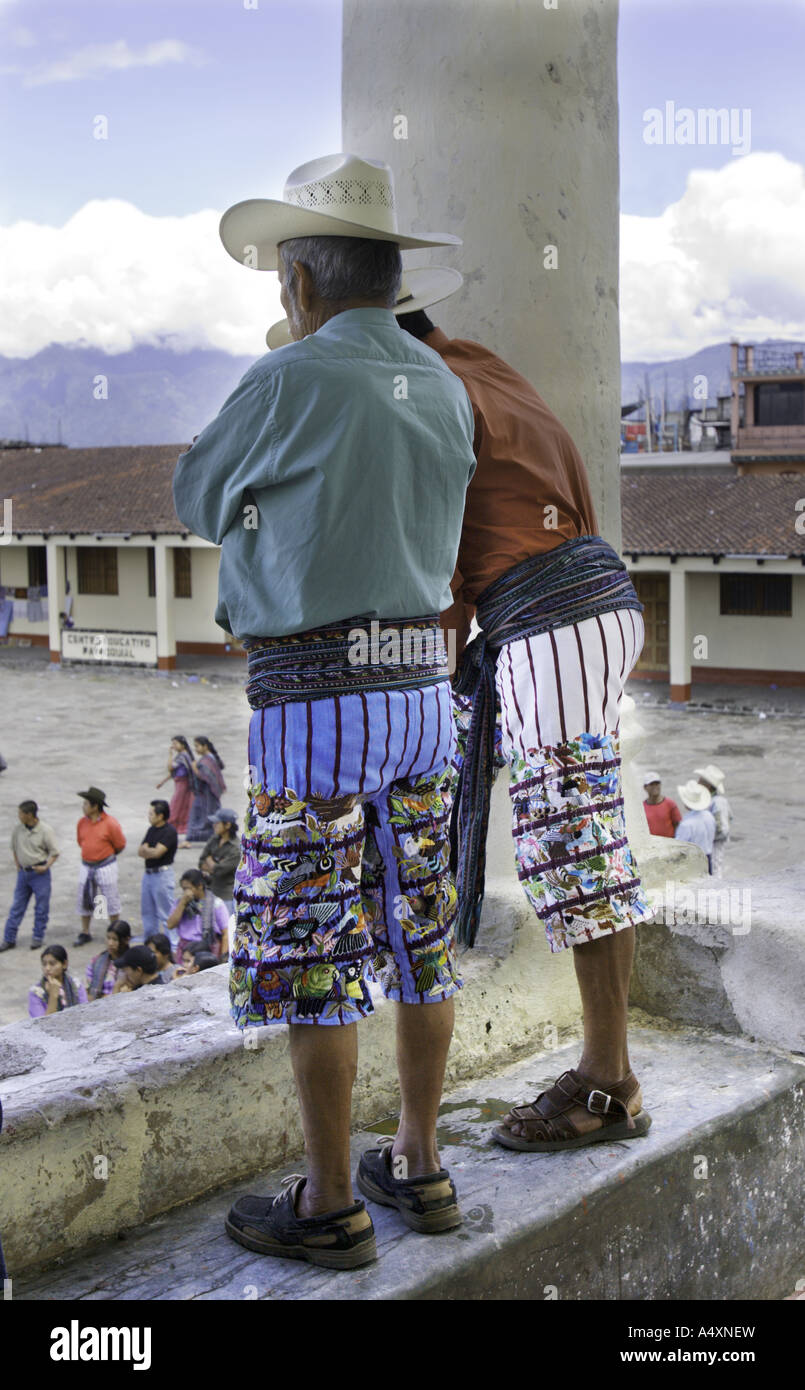 GUATEMALA SANTIAGO ATITLAN Indigenous Maya Tzutujil men in traditional woven embroidered pants and sash - Stock Image