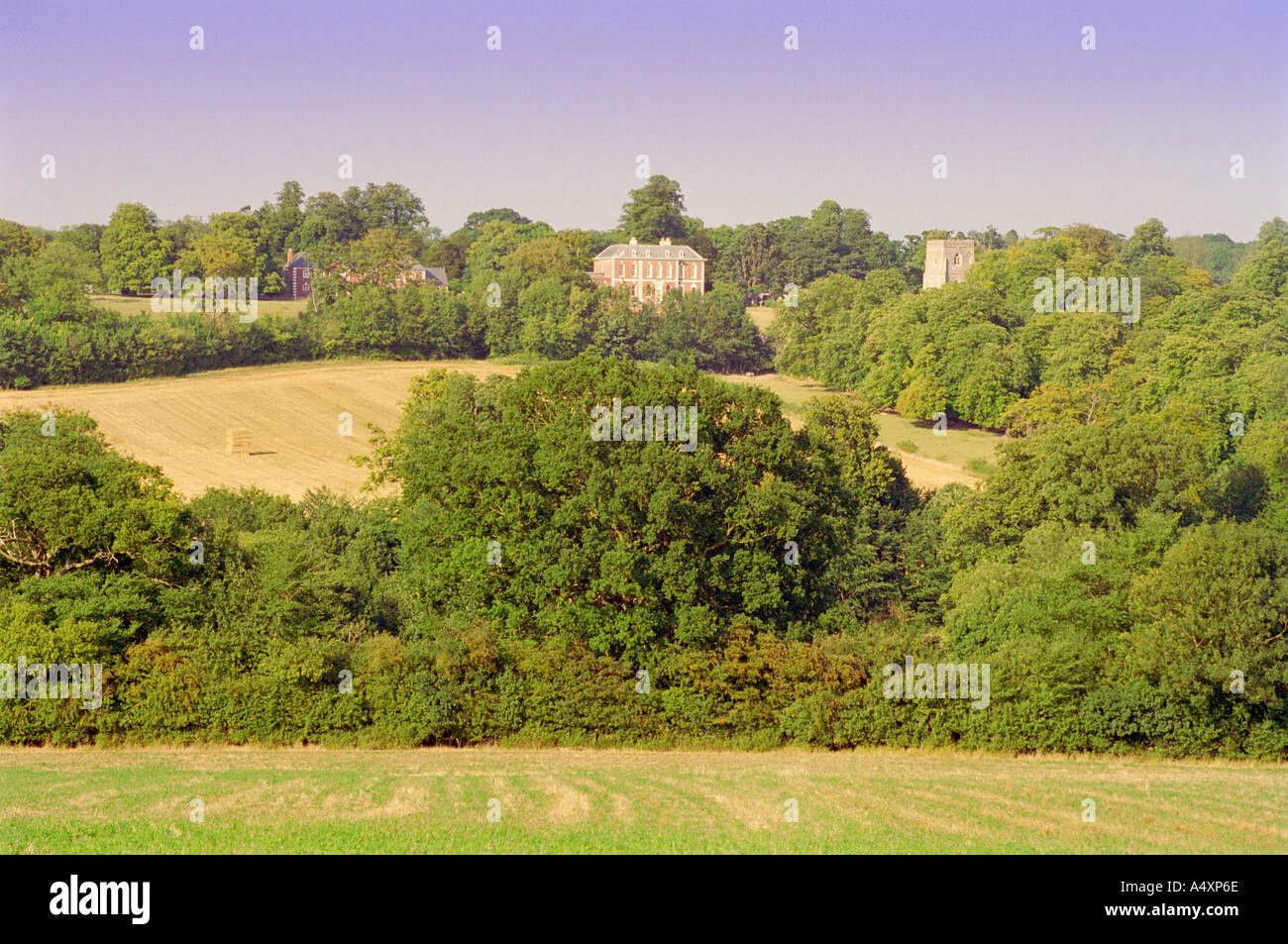 View across countryside to Dalham Hall and church Suffolk England UK - Stock Image