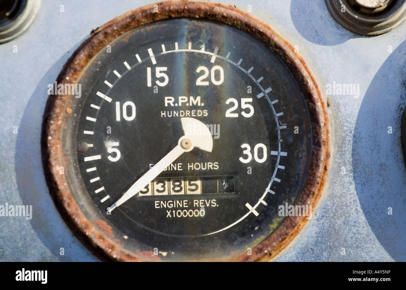 RPM engine guage rusted - Stock Image