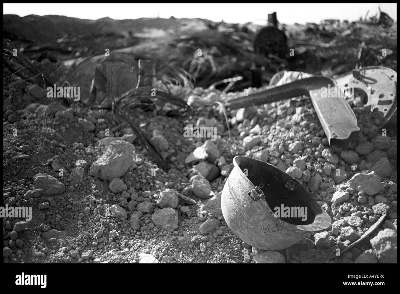 Helmet in scrap metal of diffrent battles, Kirkuk - Stock Image
