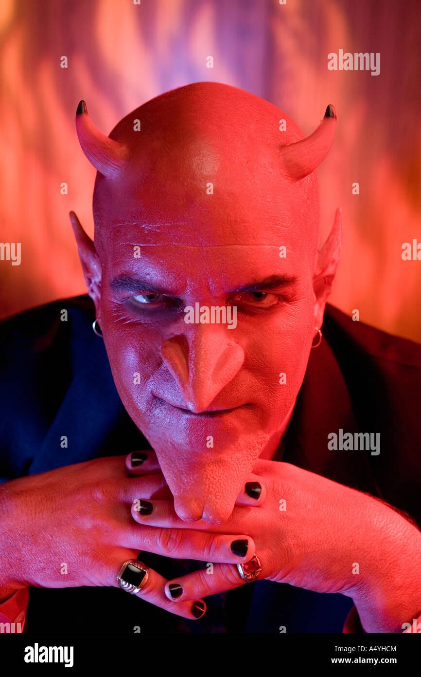 Close up of businessman dressed as devil - Stock Image