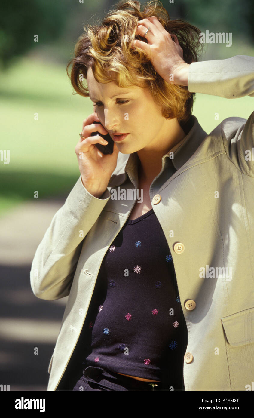 woman on her phone outside - Stock Image