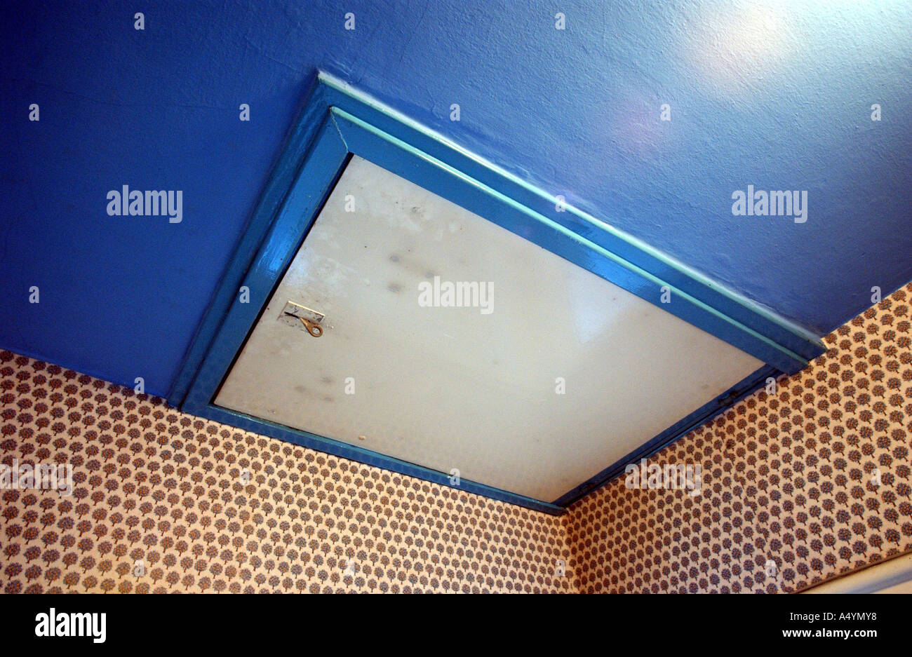 Attendance In The Parents House: Detail And Memories. Roof Hatch, Hatch To  The Roof With Stairs On Blue Reason With Flower