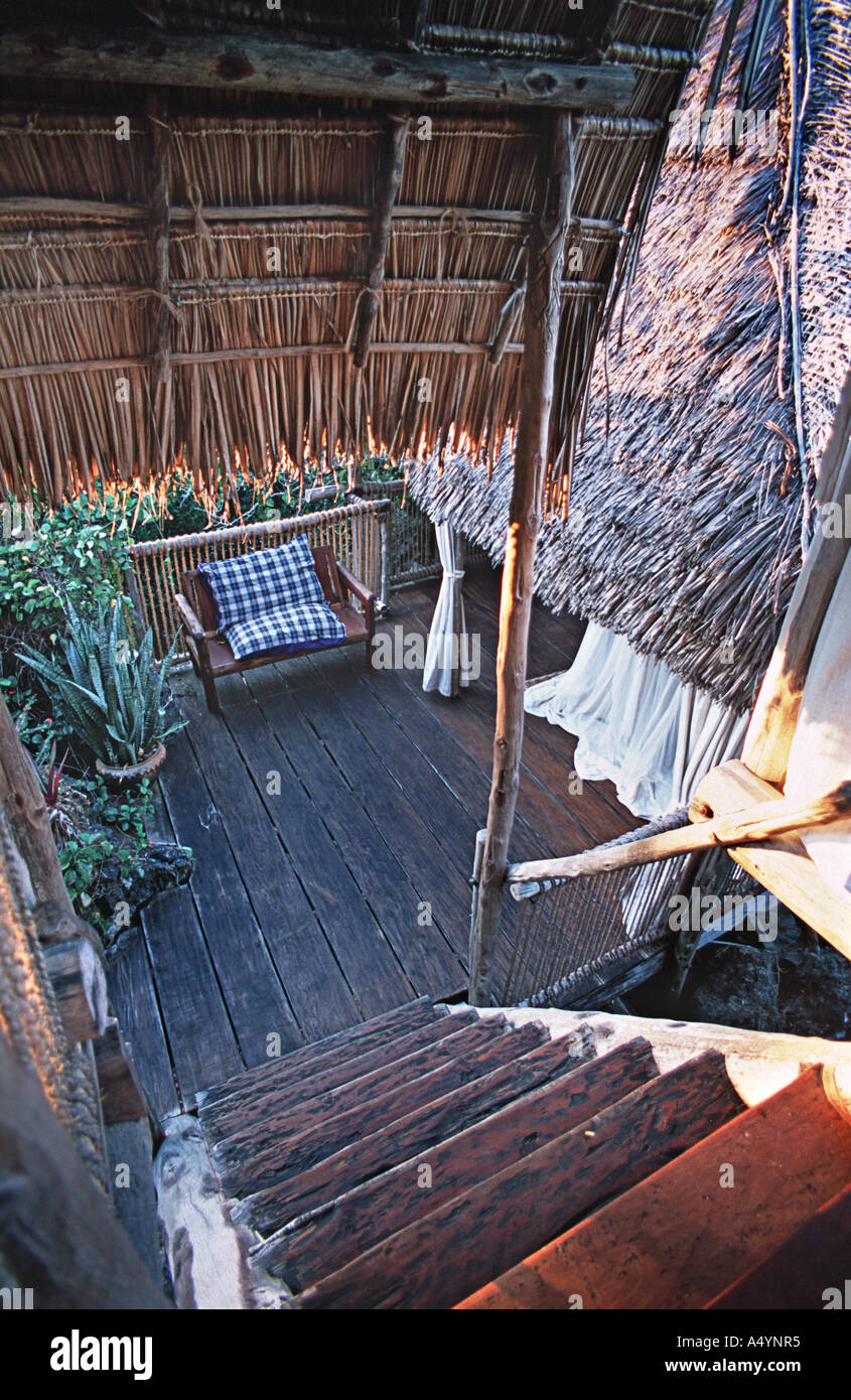 simple interior of one of the elevated luxury treehouses built around a giant boabab tree at Chole Mjini Mafia island Tanzania - Stock Image