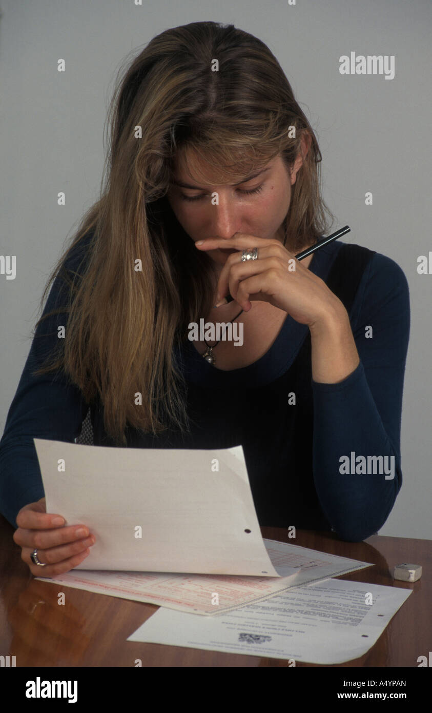 woman filling in forms - Stock Image