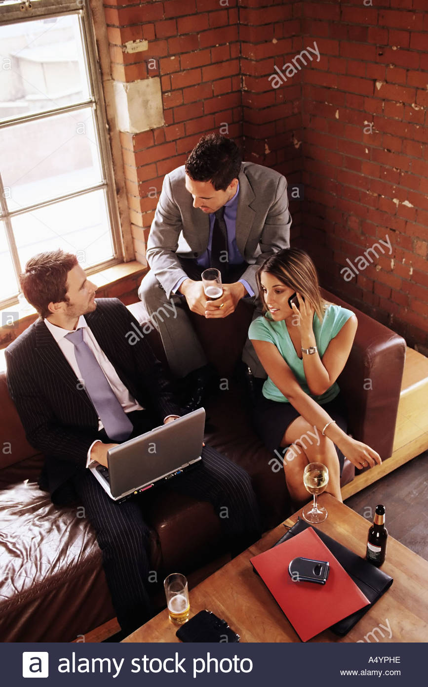 Colleagues in a bar - Stock Image