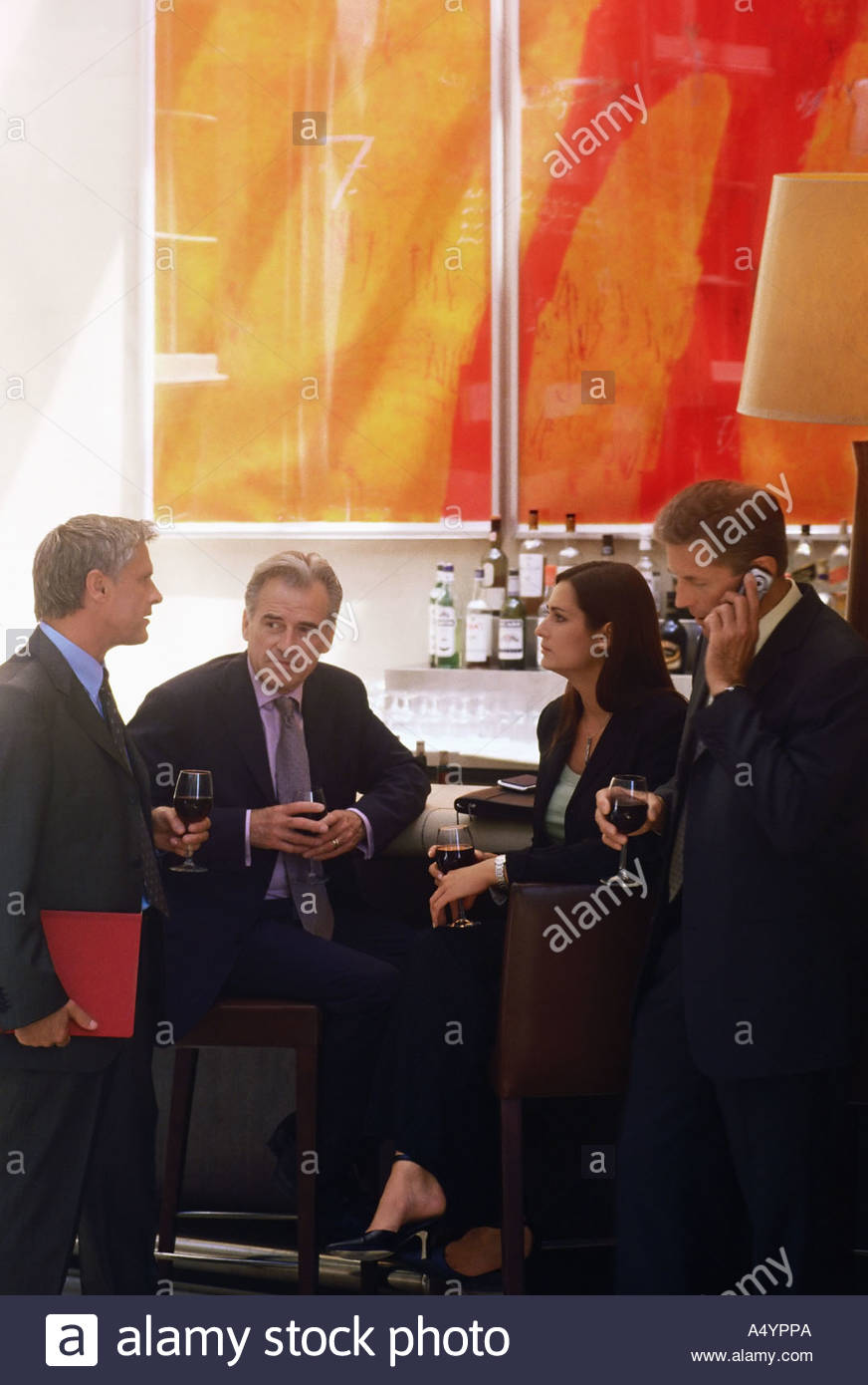 Business people in a bar - Stock Image