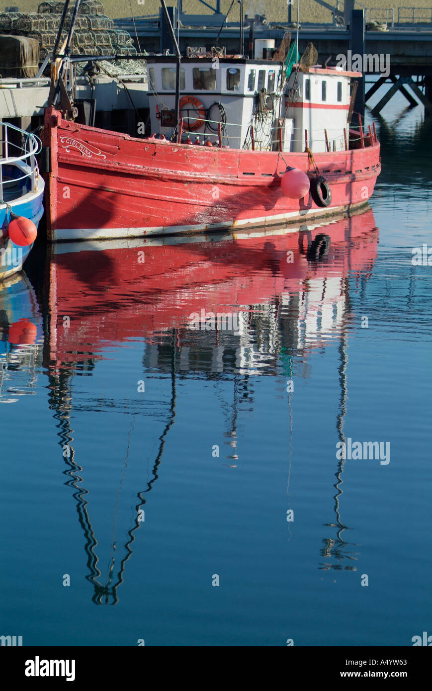 dh Stromness Harbour STROMNESS ORKNEY Red hulled converted trawler diving boat at quayside dive reflect Stock Photo