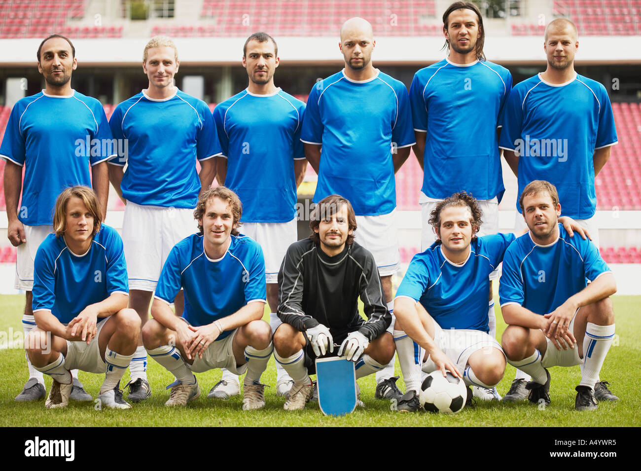 Football team in blue - Stock Image