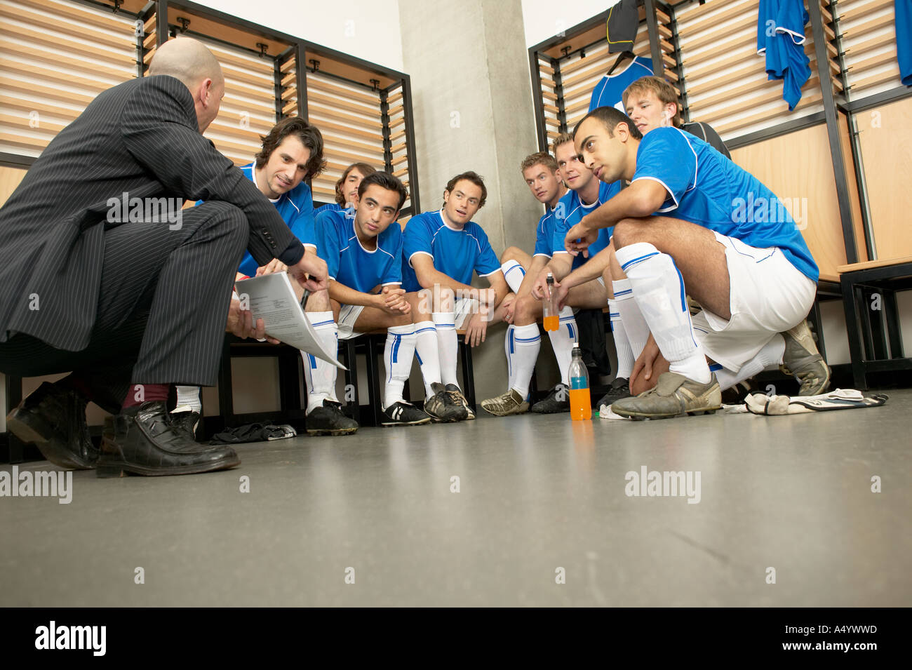 Coach with football team - Stock Image
