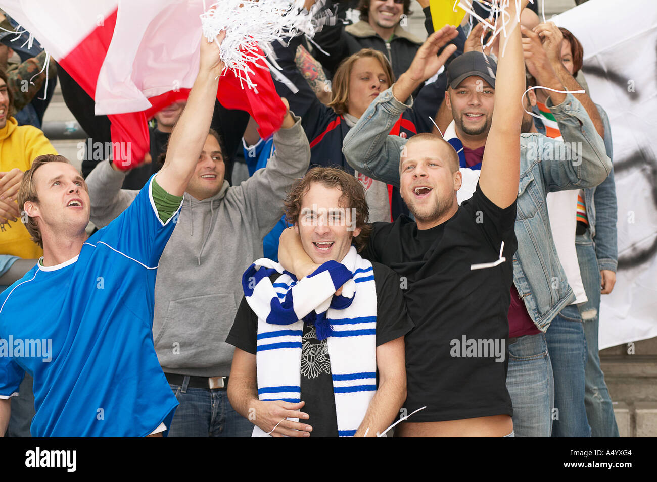 Football supporters cheering - Stock Image