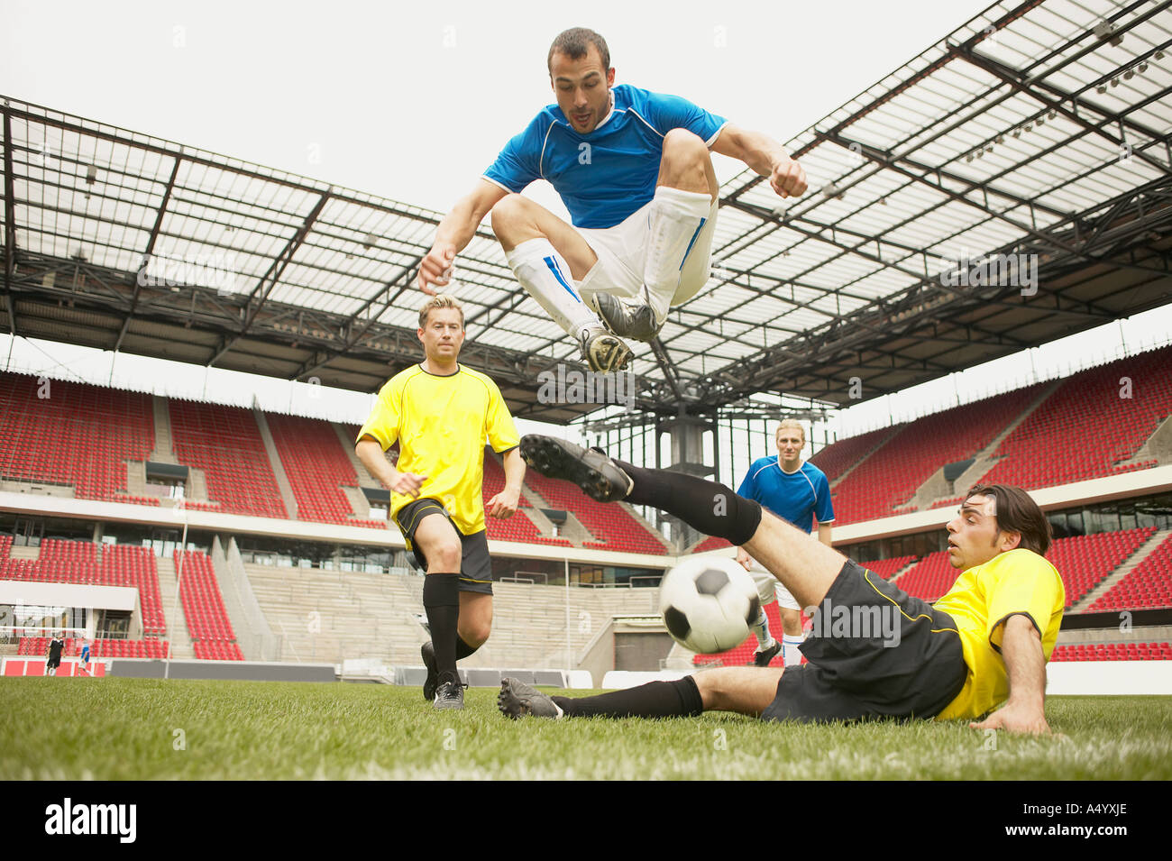 Footballers tackling - Stock Image