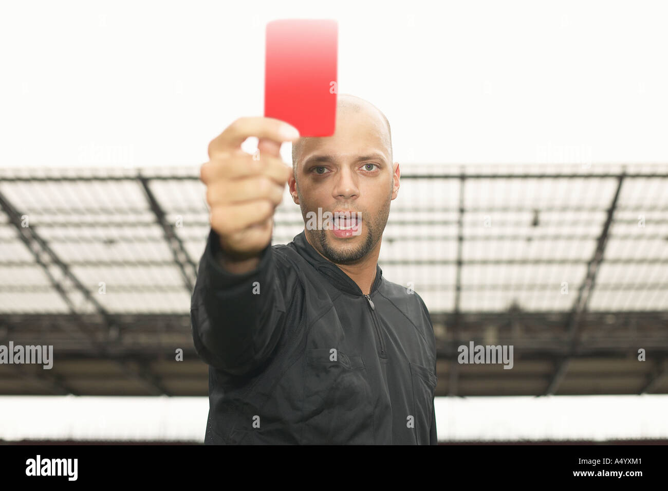 Referee giving red card - Stock Image