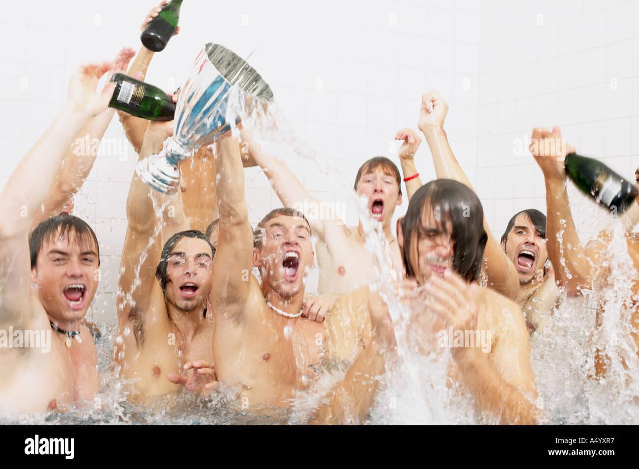 Winning football team in the bath - Stock Image