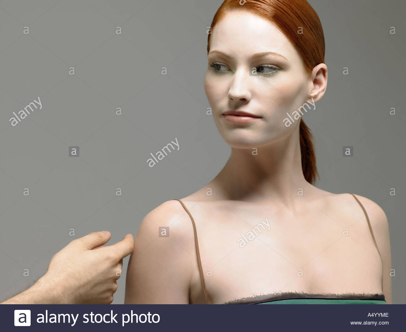 Woman having her arm touched - Stock Image