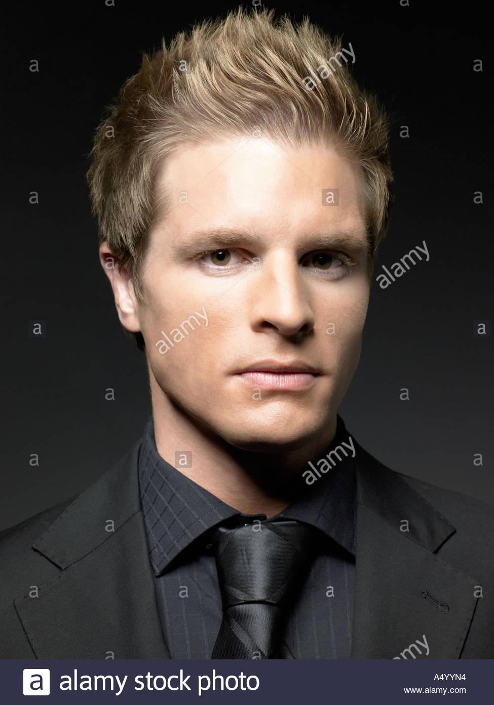 Young man wearing black - Stock Image