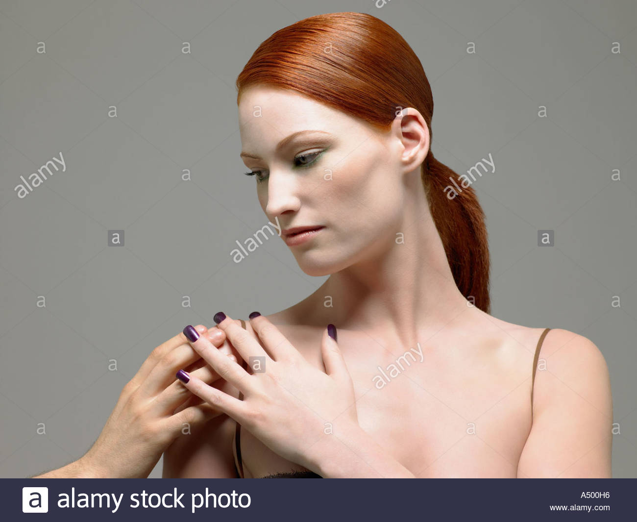 Woman having her shoulder touched - Stock Image