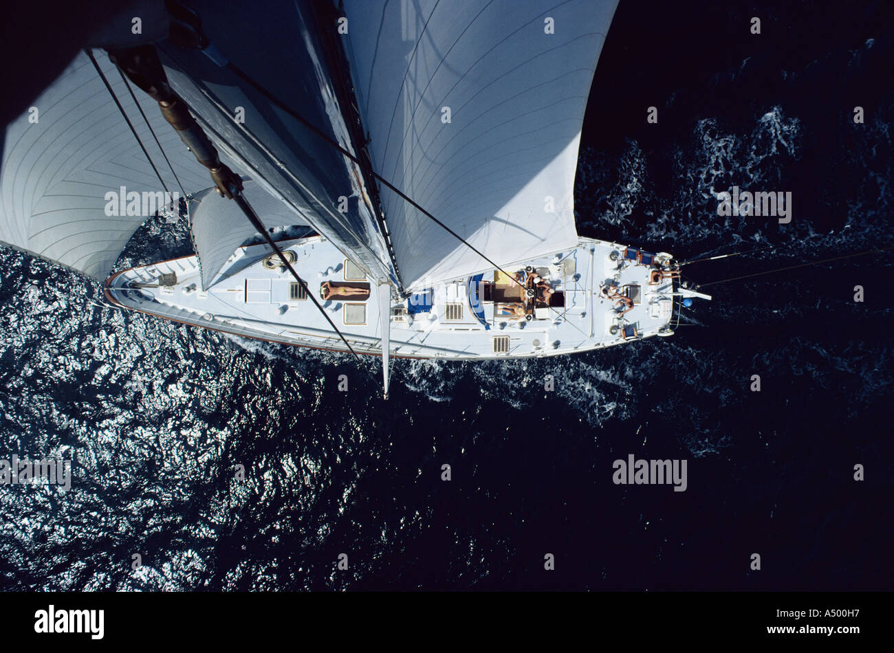 Sunbather on sailboat - Stock Image