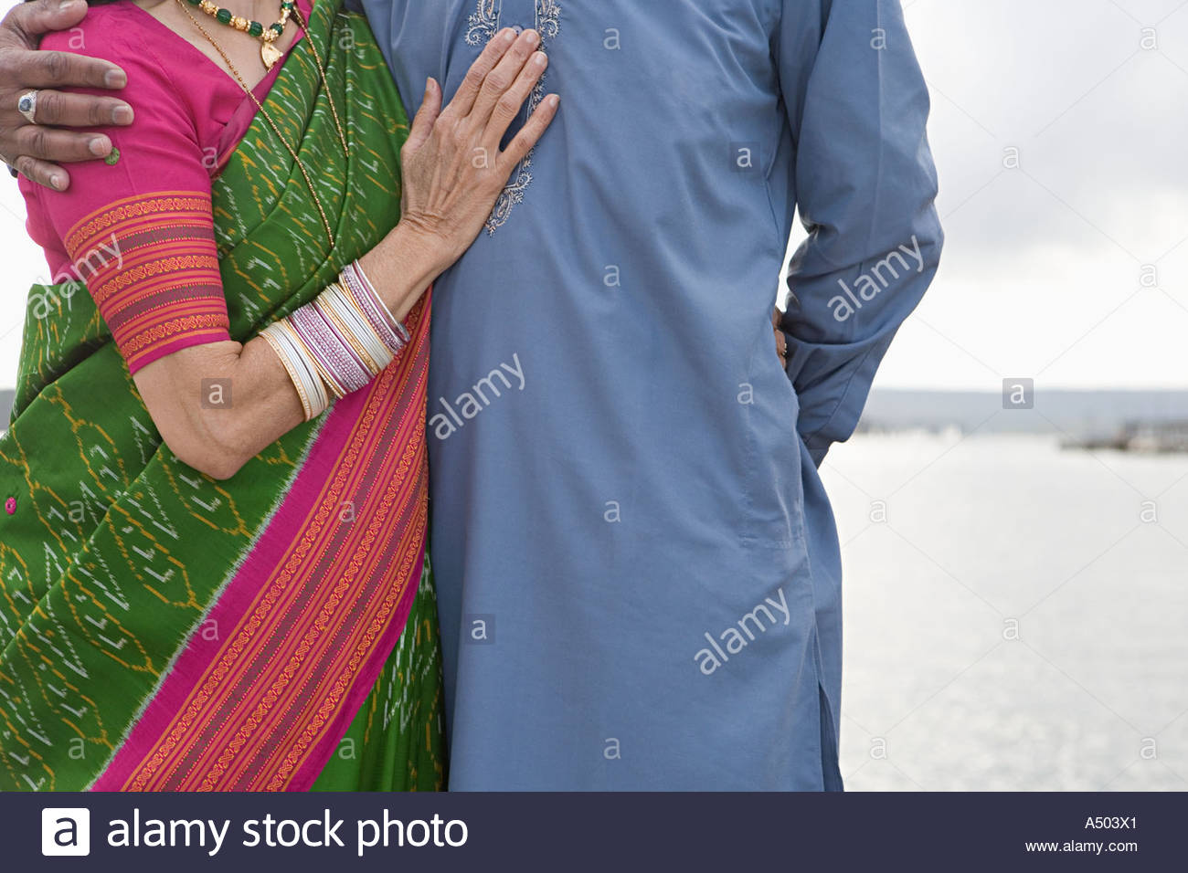 Indian couple by the sea - Stock Image