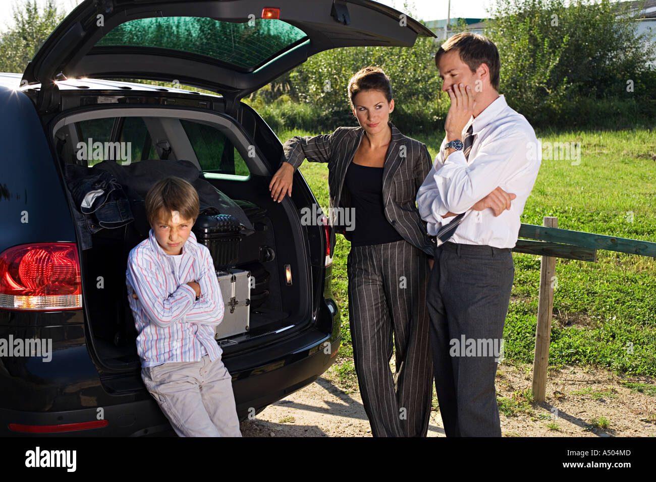 Family with broken down car - Stock Image