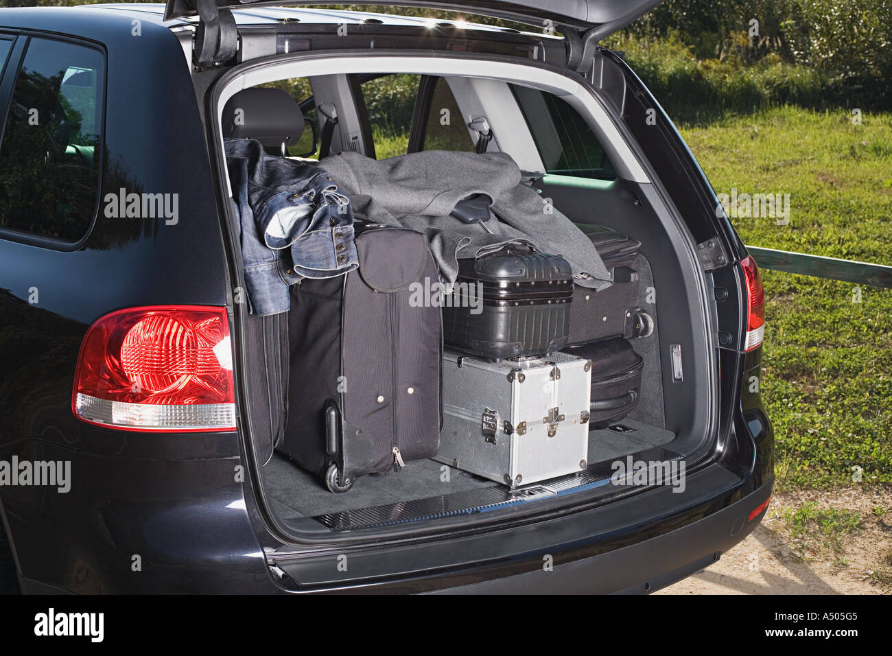Luggage in a car boot - Stock Image