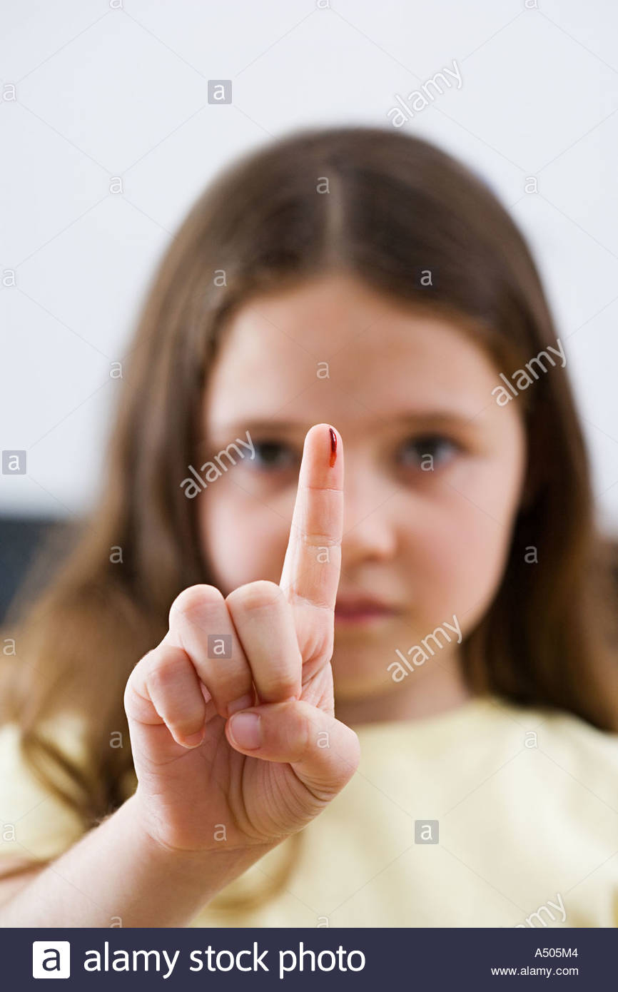 Girl with blood on her finger - Stock Image