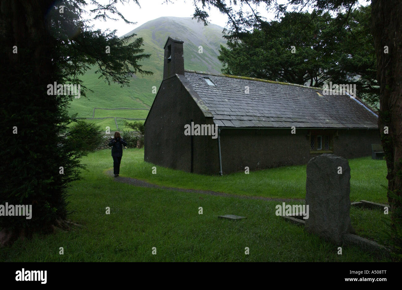 COPYRIGHT PIC BY HOWARD BARLOW - WASTWATER in the Western Lakes the smallest church in England St OLAF s - Stock Image