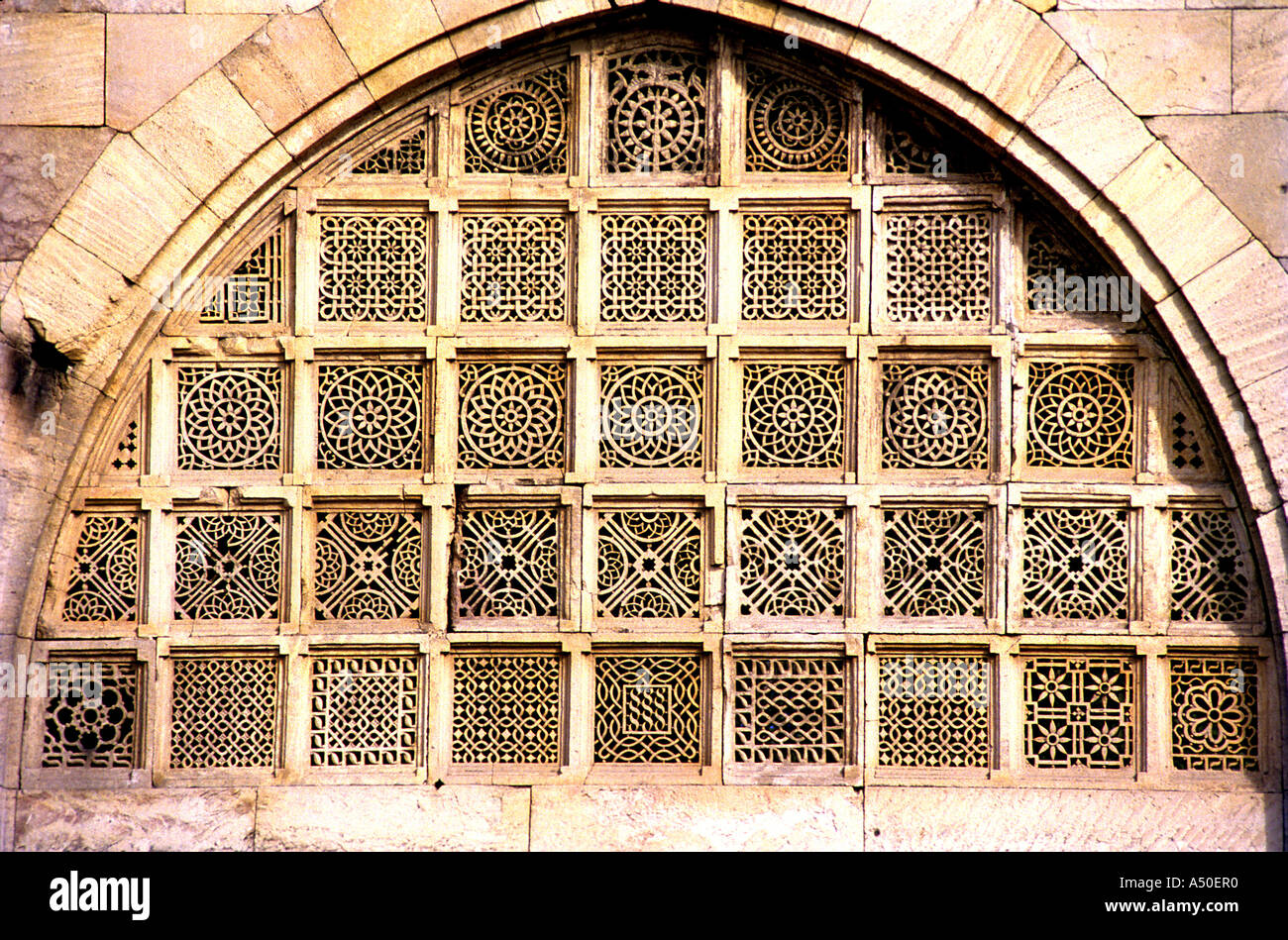 Carved stone window at Sidi Sayyedi s mosque at Ahmedabad in Gujarat India - Stock Image