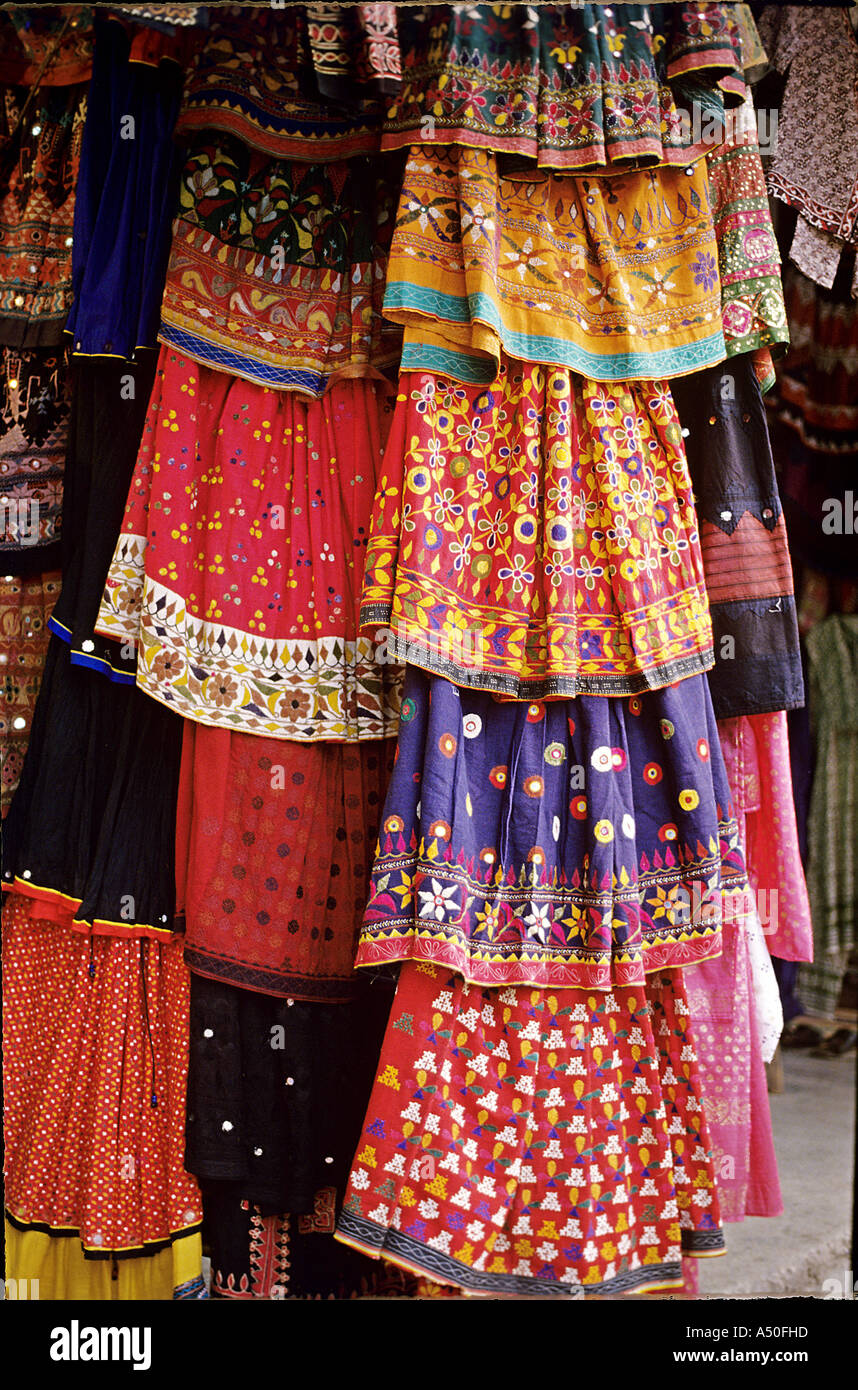 Embroidrered skirts hanging in front of a shop at Janpath in Connaught Place in Delhi India - Stock Image