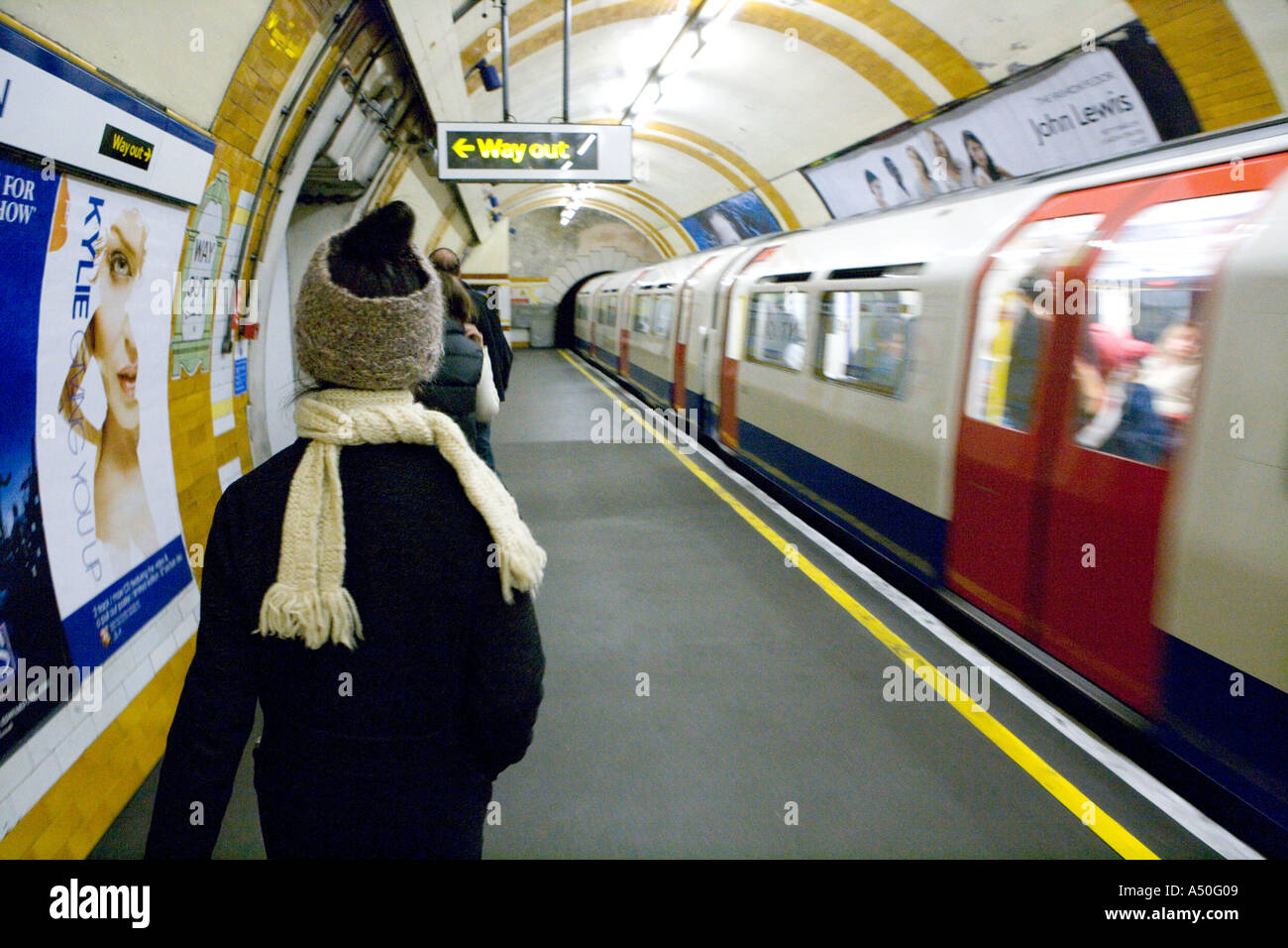 Moving Tube train and commuters London England Stock Photo