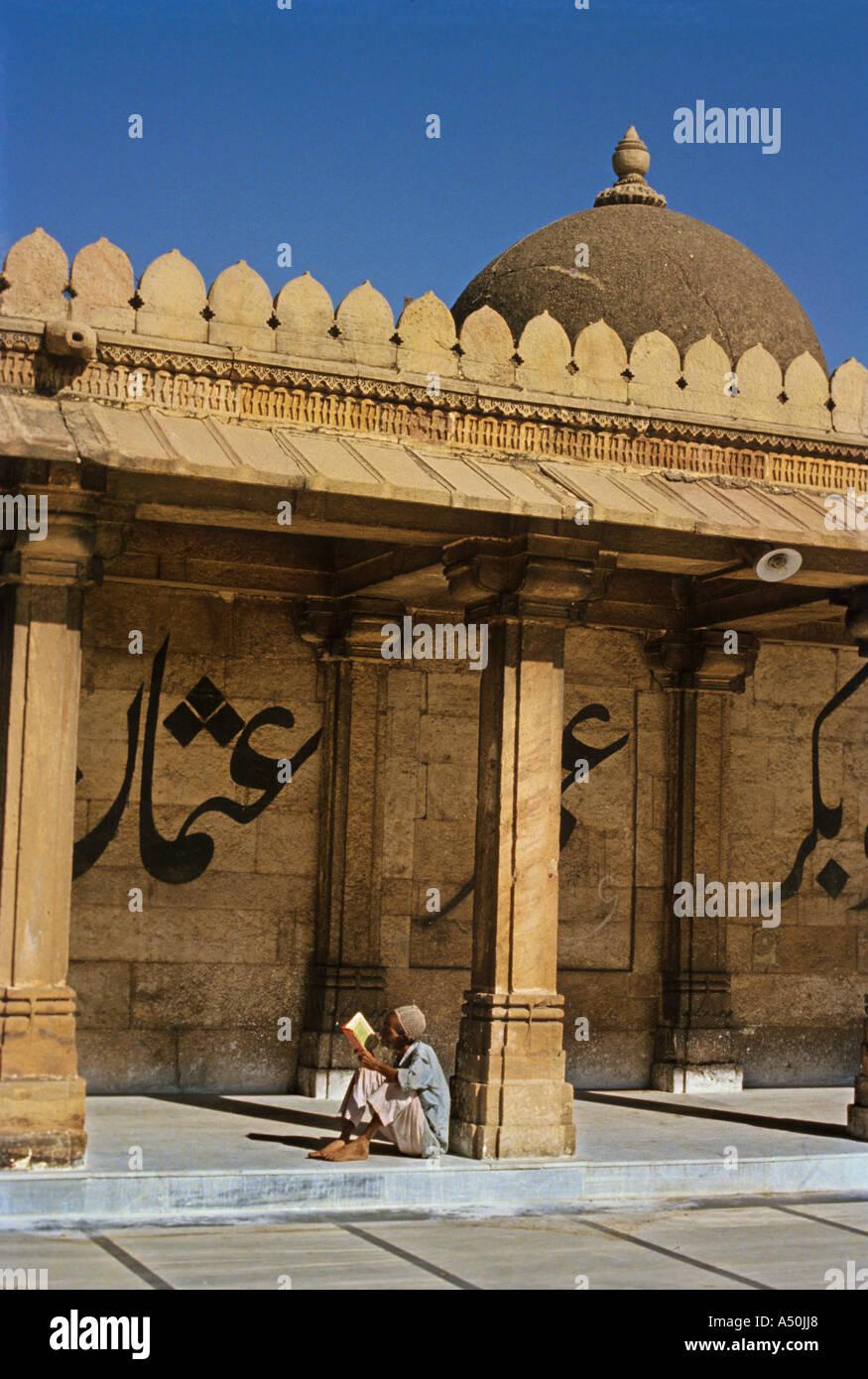 Man sitting at Juma Masjid at Ahmedabad in Gujarat India - Stock Image