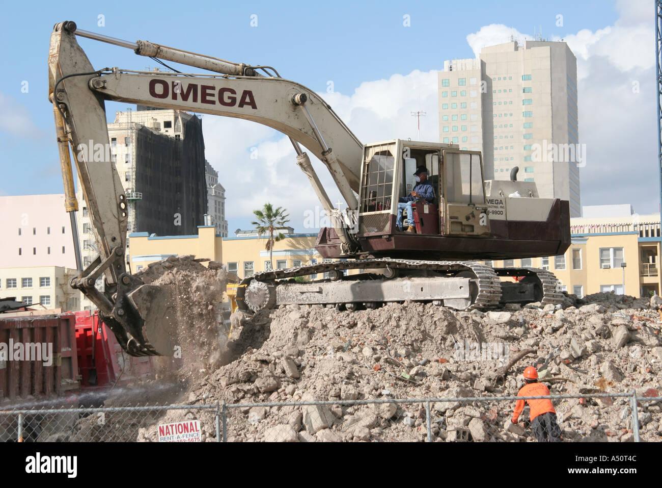 Miami Florida Biscayne Boulevard demolished building debris backhoe construction - Stock Image