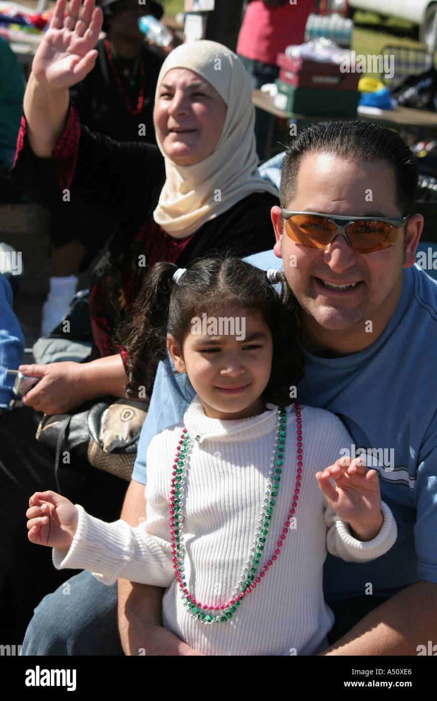 Miami Florida Bayfront Park Greater Miami Mardi Gras Muslim family watches parade - Stock Image