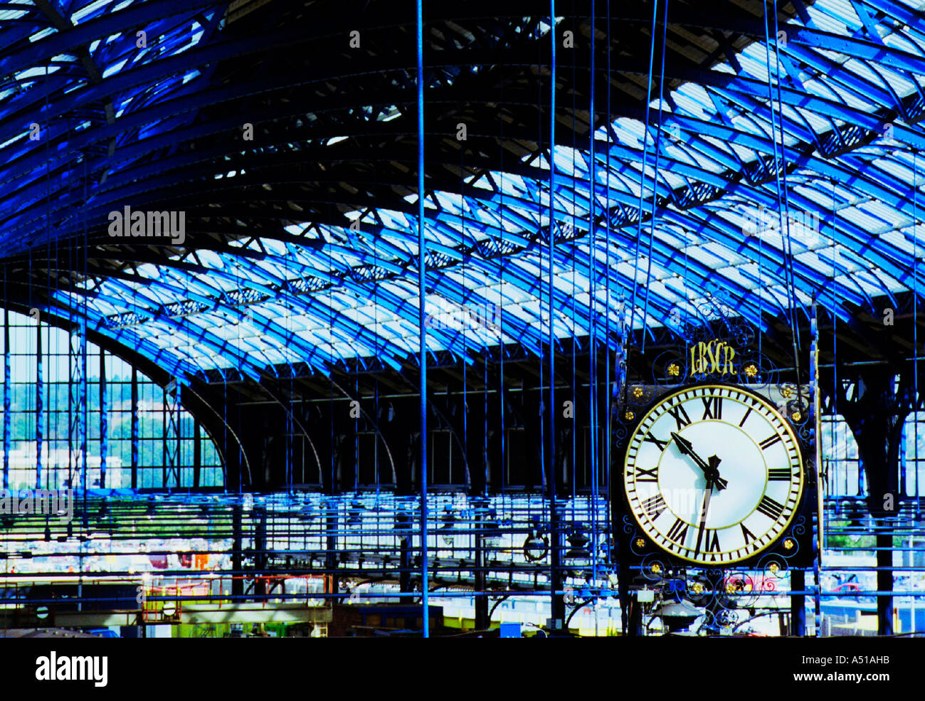 The newly restored roof of Brighton Station with the original Victorian clock - Stock Image