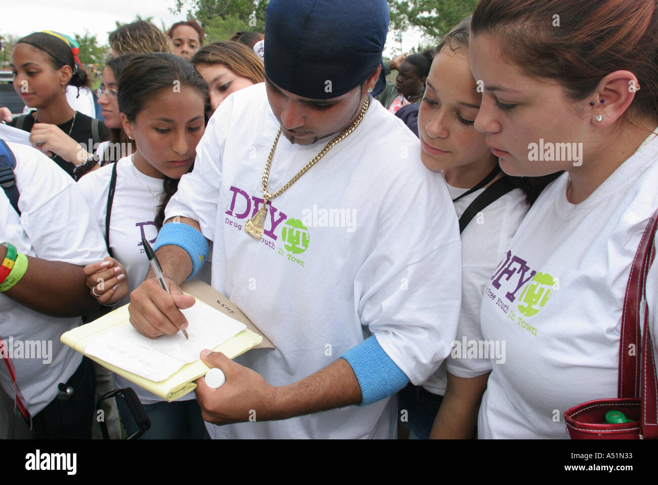 Miami Florida MetroZoo DFYIT Drug Free Fest students D County rap performer signs autograph - Stock Image