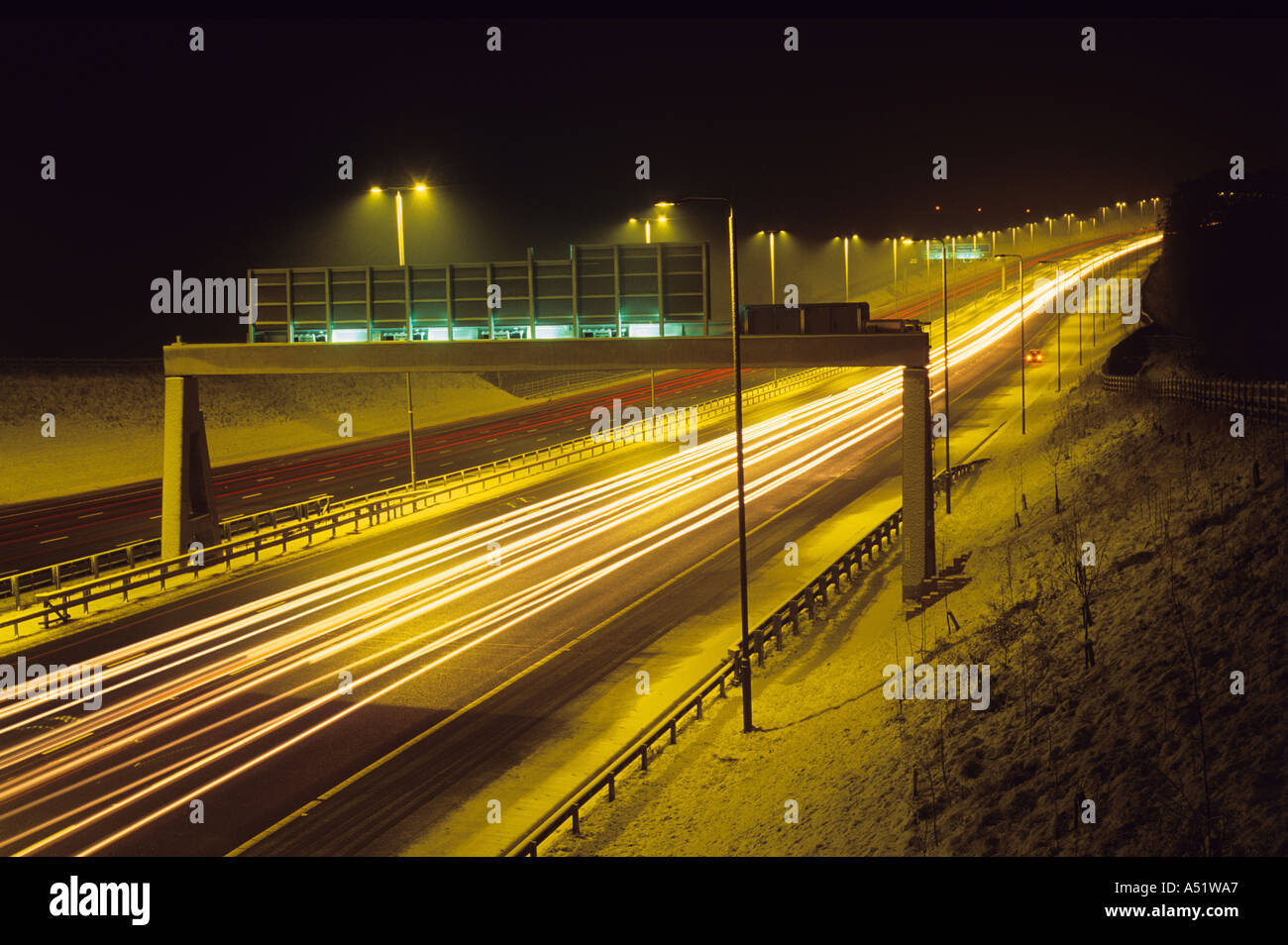 headlight trails of traffic travelling on the a1 m1 motorway in wintertime at night near leeds uk Stock Photo